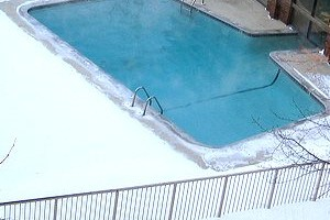 heated outdoor swimming pool in winter snow